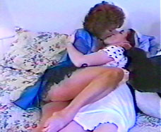 mature woman kissing young girl