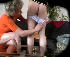 Picture of the mom stripping her daughter nude from the dvd.