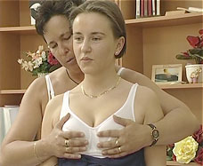 girl gets her tits squeezed by mom