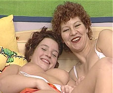 mother and daughter nude in bed together
