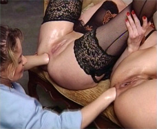 Girl is anal fisting two mature women.